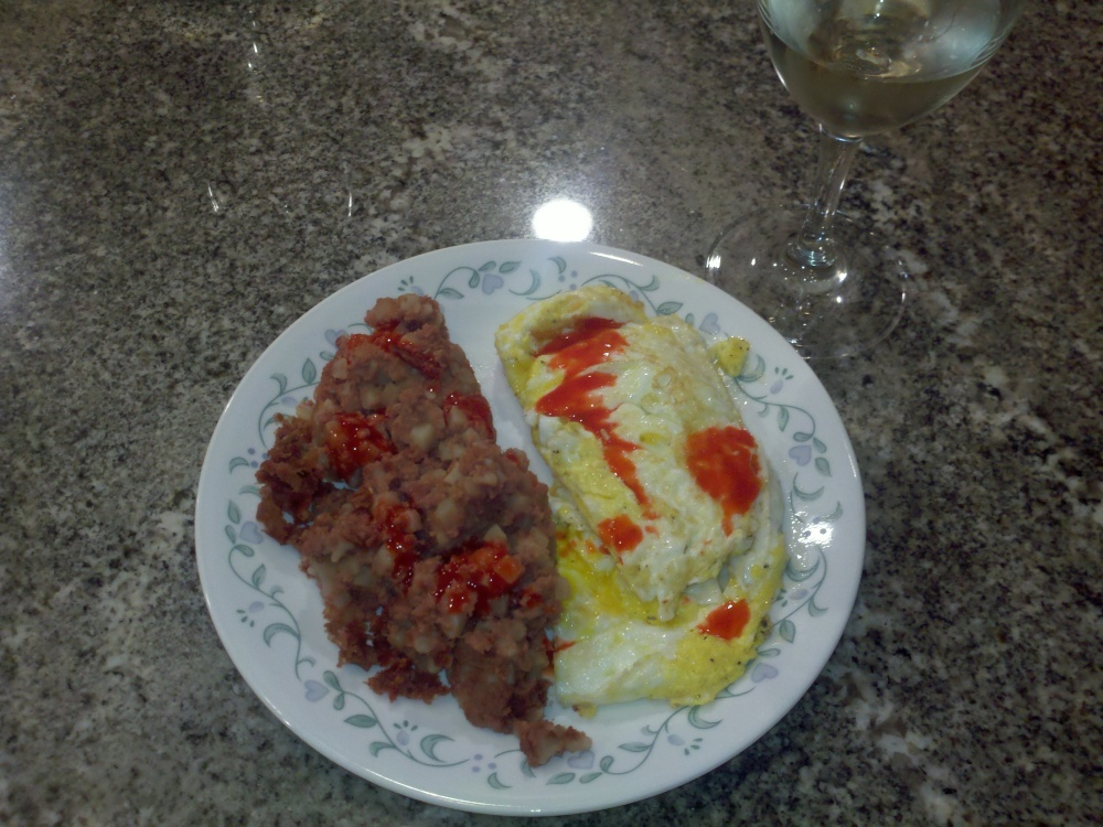 Milford NH :: beef hash with eggs over hard and Goya hot sauce with a glass of white wine