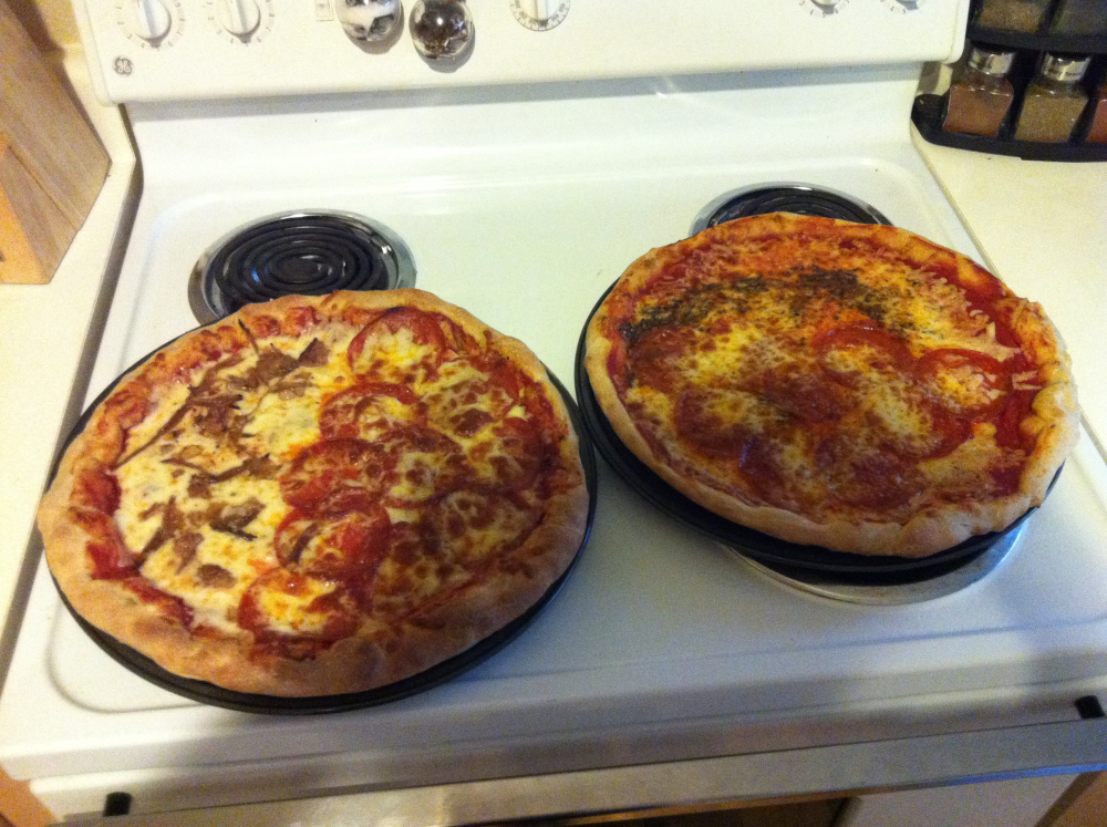 Austin, TX. :: I made pizza for friends. Russ had a really good idea. We lined the crust with Gouda. The pizzas were 50/50 cheese and pepperoni. One of them also had brisket. Also, wheat dough was used. Not my call. Came from WholeFoods but it was really good.