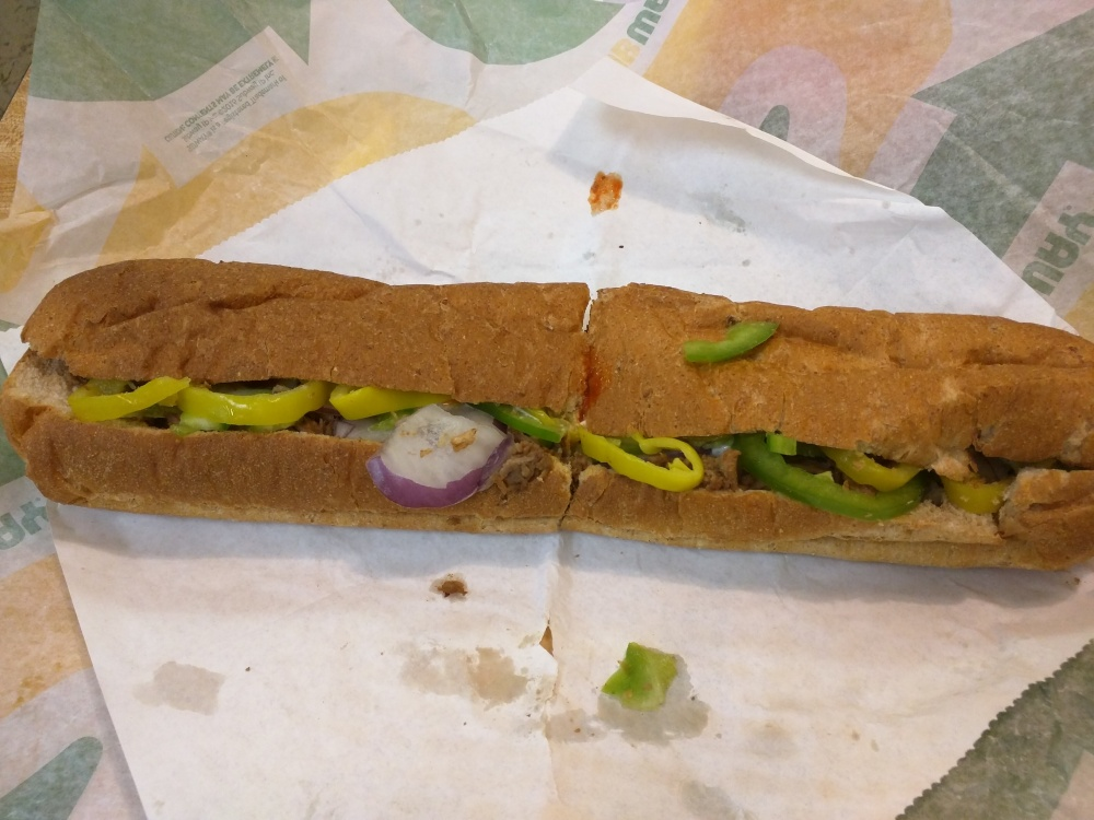 Subway in Plainville CT :: Steak and cheese on wheat: American, onions, peppers, banana peppers, buffalo sauce, mayonnaise.  THE BEST