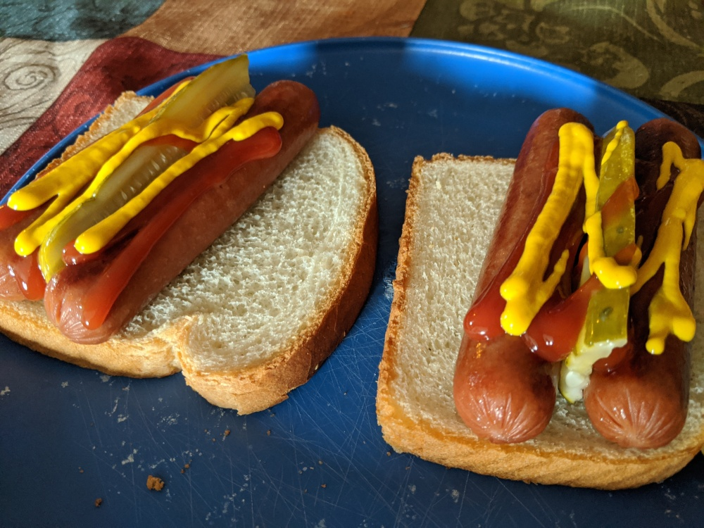 I ate this like a king :: Dogs on slabs of white bread, how else?