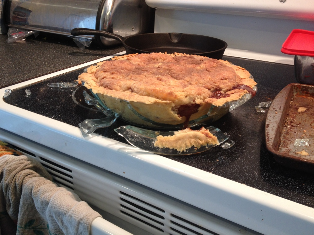 Plainville, CT, USA :: I was baking an apple pie for Pi Day but little did I know that putting a hot pyrex pie pan on a flat stovetop was a bad idea. POP glass went everywhere.  Didn't get to eat this....