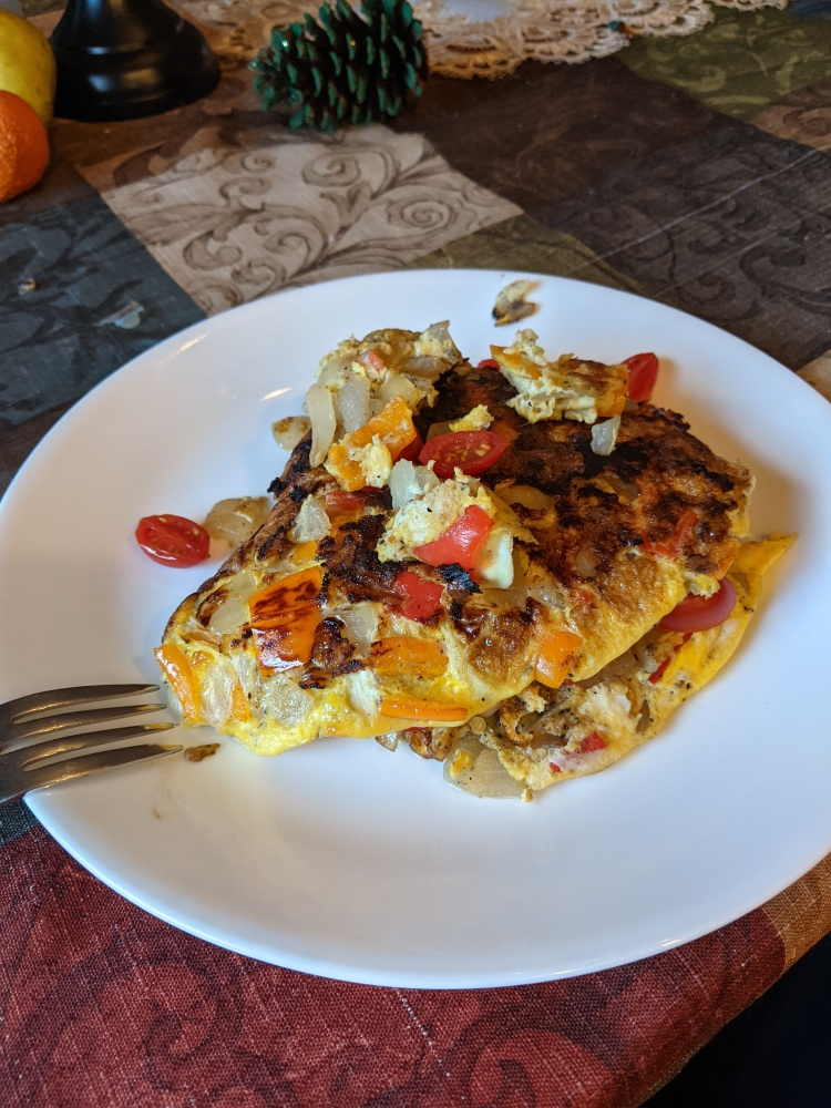 Plainville, CT, USA :: Sunday morning omelette. Tomato onion pepper sharp cheddar cheese